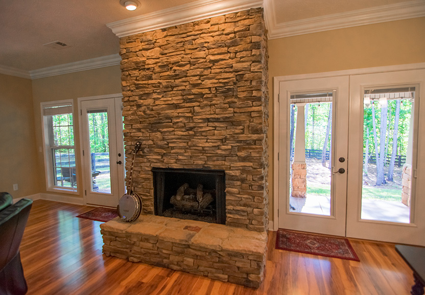 fireplace in 44 viburnum way, pine mountain ga, stone wall, fire place, doors, glass, john bunn realty