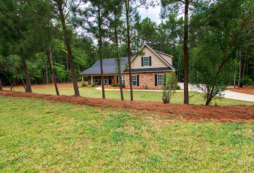side view of 44 viburnum way, pine mountain ga, greenery, trees, housing, john bunn realty