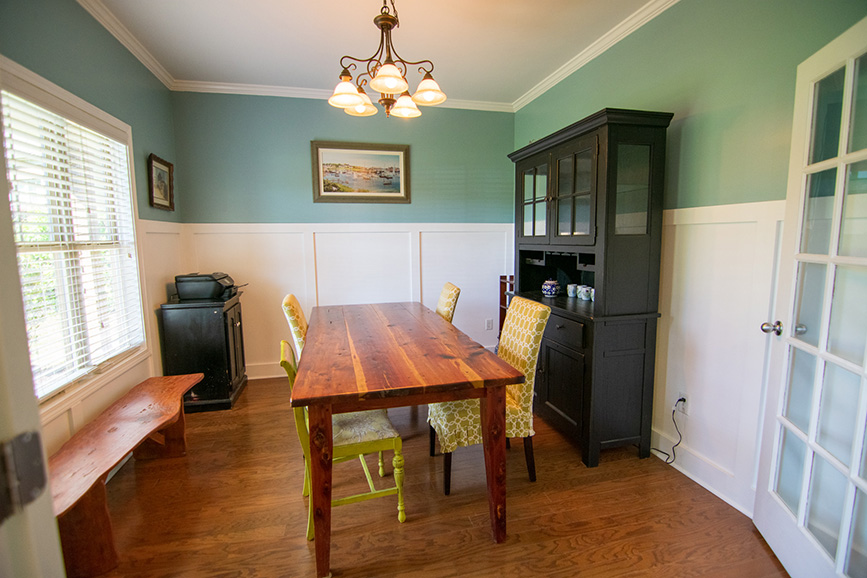 Home in Columbus ga with wood table and blue walls