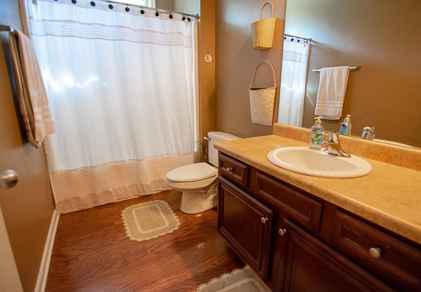 John Bunn realty bathroom with wood floors in columbus ga