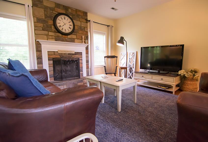 Living room in john bunn realty, columbus, ga, hardwood floors, area