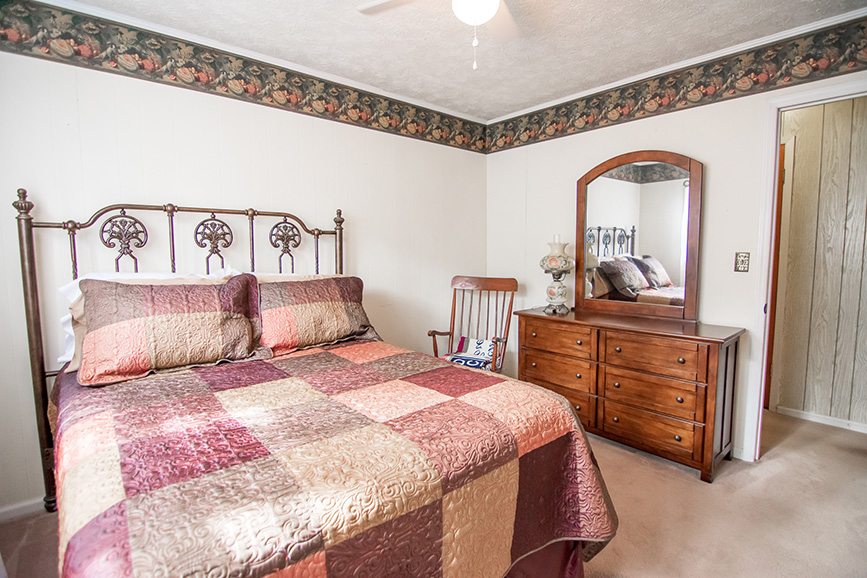 Beautiful bedroom in 45 Dogwood Terrace Ellerslie GA listed by John Bunn realty in harris county ga