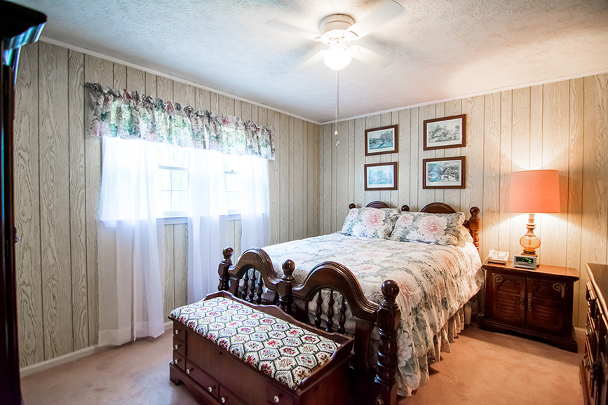 Master bedroom in Ellerslie GA with a beautiful covers john bunn realty