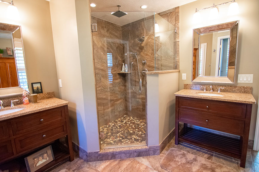 bathroom with 2 sinks and shower john bunn realty