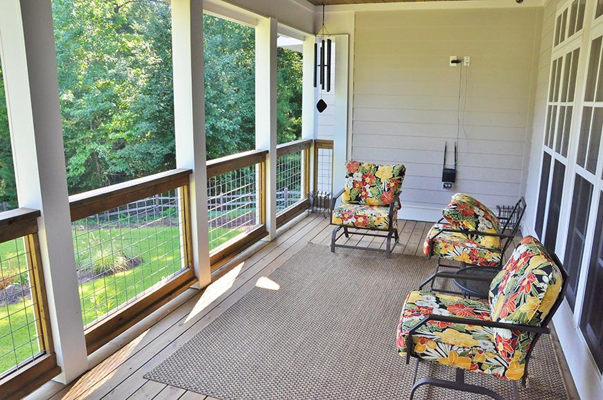 porch overlooking back yard john bunn realty