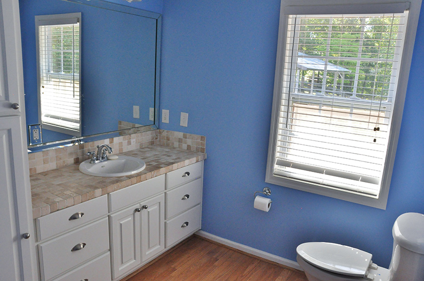 sink and toilet in bathroom john bunn realty house for sale