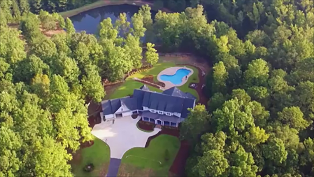 overhead of house for sale with pool john bunn realty