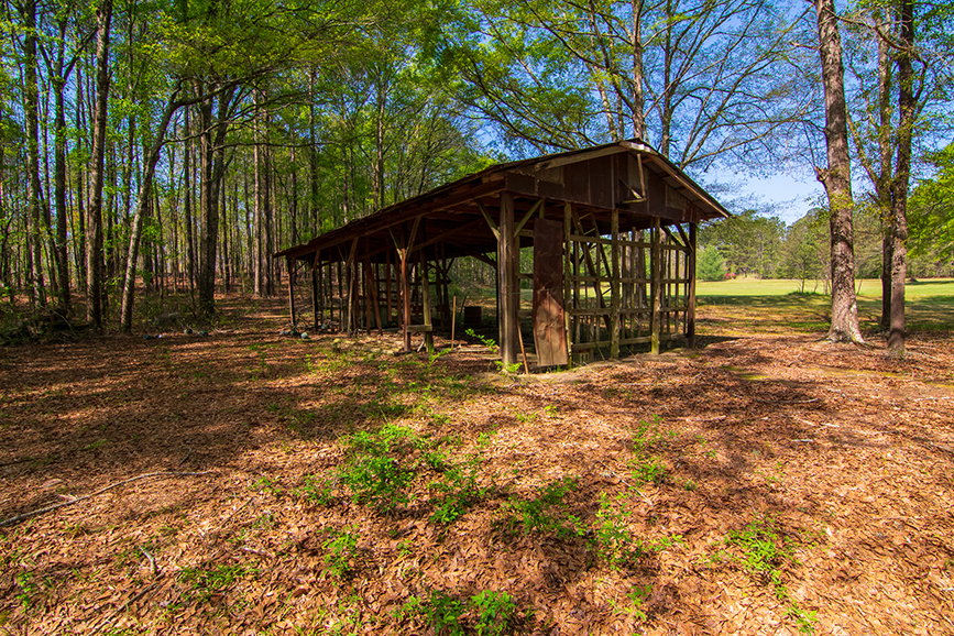 wooden roof covered open shed, John Bunn Realty, 18420 GA Highway 116 Shiloh, GA, Columbus, Georgia, surrounded by trees, forested area, property for sale, open areas around